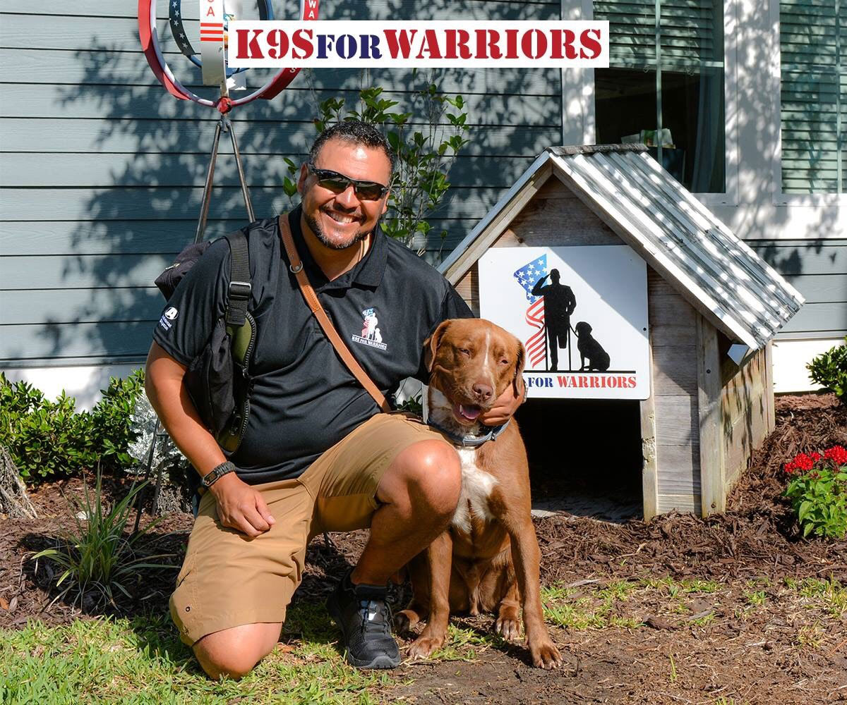 Richard Baca II and his service dog Jersey